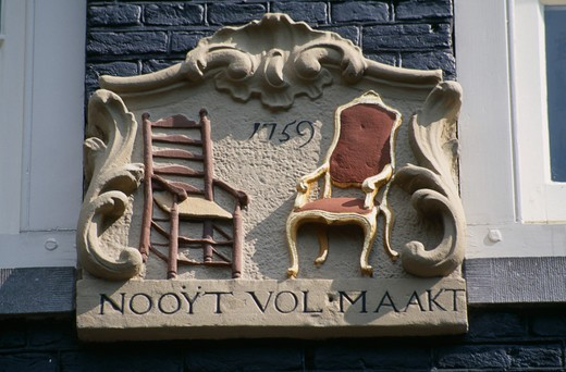 Stock Photo: 1850-7772 Holland, Noord, Amsterdam, Close Up Detail Of A Wall Tablet Used Before House Numbers Were Added