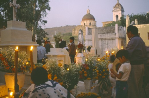 Stock Photo: 1850-7855 Mexico, Puebla, Acatlan, People Keeping Vigil Beside Graves Decorated With Candles And Flowers During Night Of The Dead