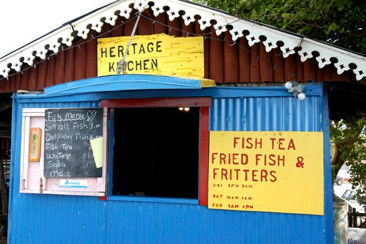 West Indies, Cayman Islands, Fish House With Menu Board Outside Small Opening : Stock Photo