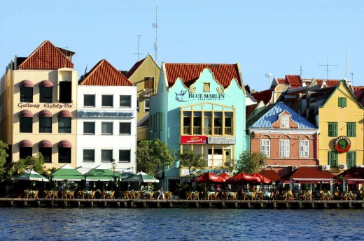 West Indies, Dutch Antilles, Curacao, Old Willemstad. Row Of Brightly Painted Waterfront Restaurants And Cafes : Stock Photo
