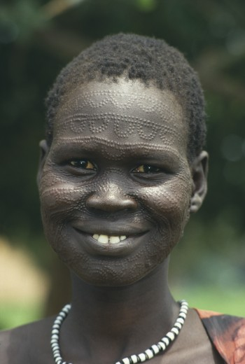 Sudan, South, Portrait Of A Smiling Neuer Girl With Facial Scarification : Stock Photo