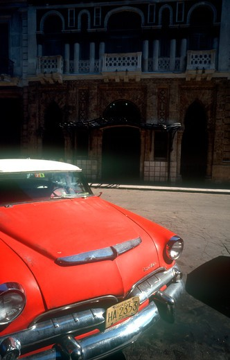 Stock Photo: 1850-868 Cuba, Havana, Detail Of Red Us Style Car Parked On Old Havana Street.