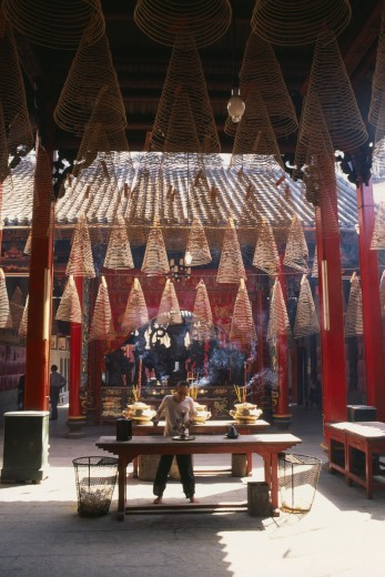 Vietnam, South, Saigon, Man At An Altar Below Coils Of Incense At Thien Hau Pagoda : Stock Photo