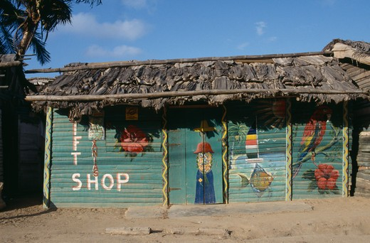 Stock Photo: 1850-8863 Dominican Republic, Architecture, Green Thatched Roadside Shop With Naive Paintings On It