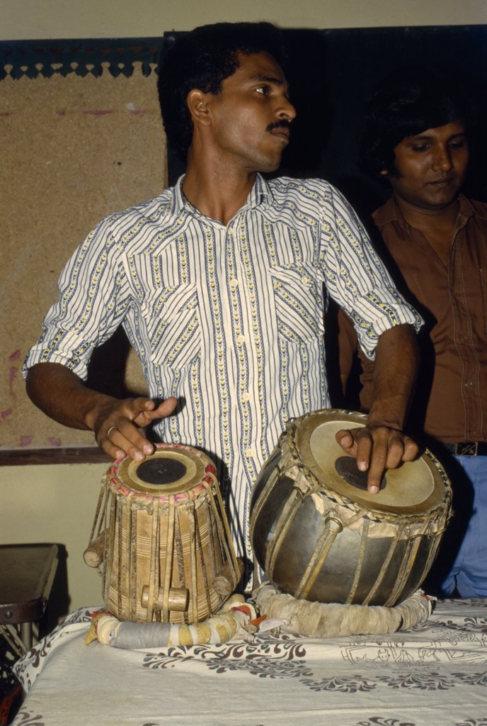 Stock Photo: 1850-9118 Bangladesh, Kamalganu, Young Man Playing Tabla Drums.