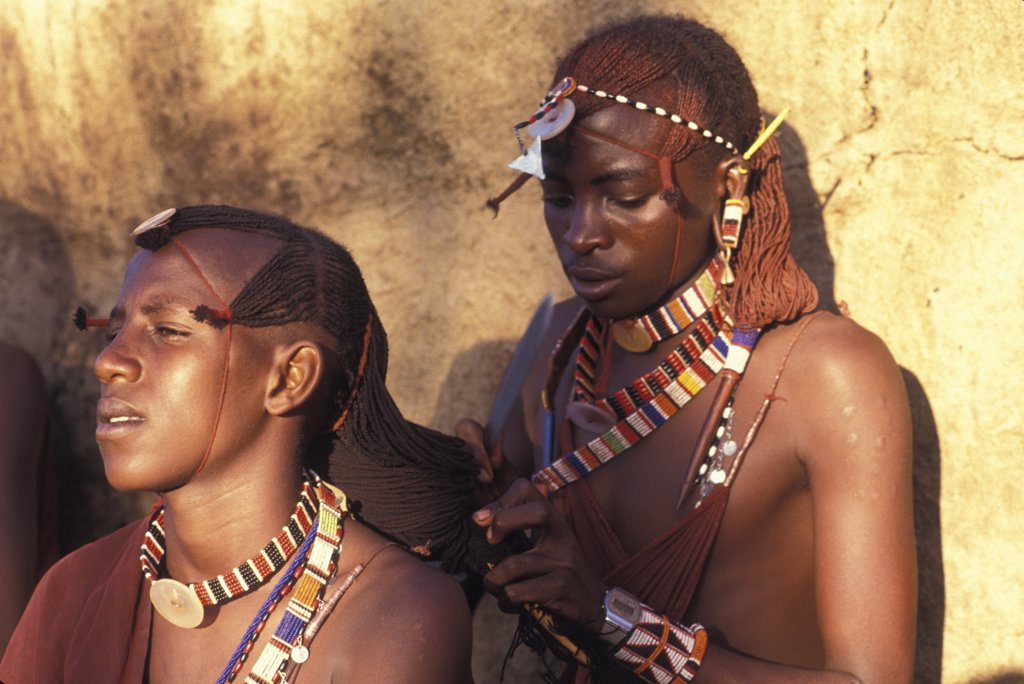 Stock Photo: 1850-9574 Kenya, , Maasai Moran Platt Each Others Hair Prior To An Initiation Ceremony That Will Take Them Into Manhood. The Moran Live In Age Sets Being Brought Up Together Like Brothers.