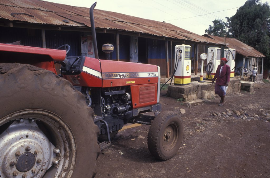 Kenya, Loitokitok, A Tractor At A Petrol Station In The Entirely Maasai Populated Town : Stock Photo