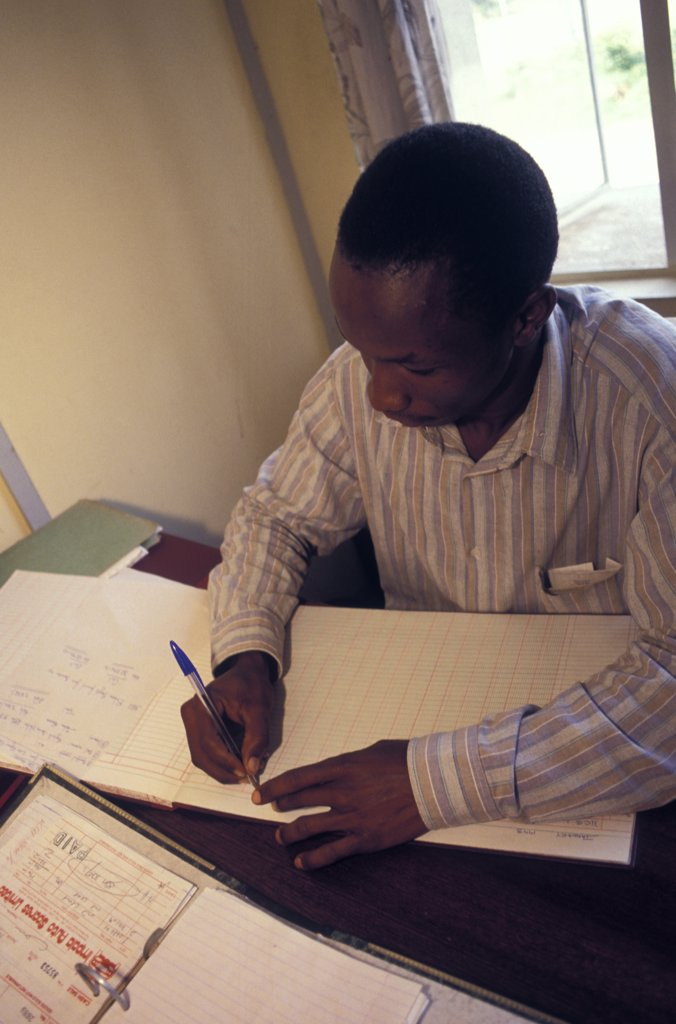 Stock Photo: 1850-9604 Kenya, , An Accountant Doing Accounts.