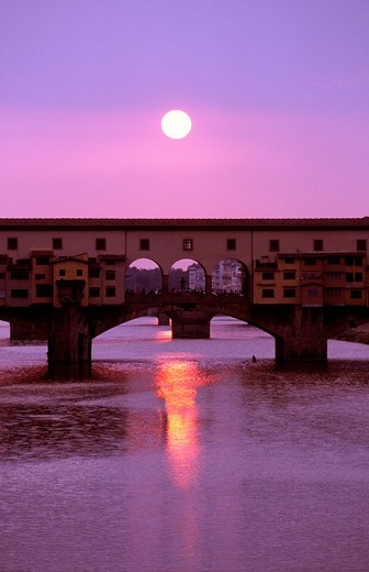 Stock Photo: 1851-5049 Sun sets behind the Ponte Vecchio bridge in Florence Italy