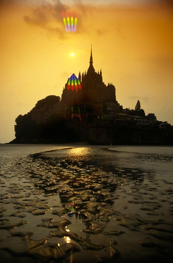 Mont St Michael at sunset on the coast of France : Stock Photo