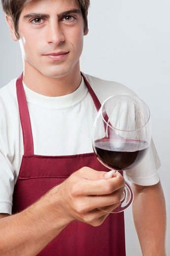 Portrait of a man holding a glass of red wine : Stock Photo