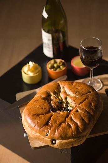 Close-up of a loaf of bread with a glass of red wine : Stock Photo