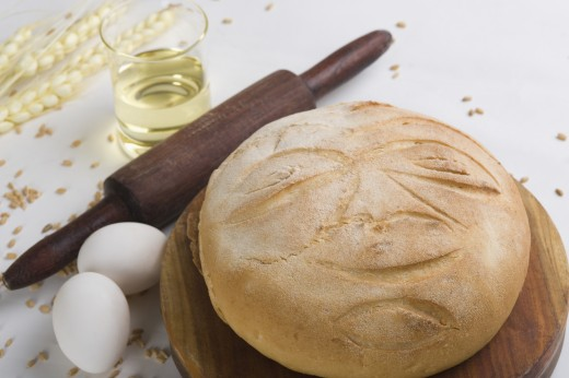 Eggs and bread with rolling pin on cutting board : Stock Photo
