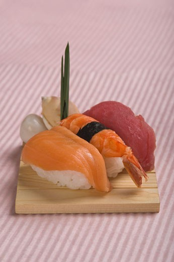 Stock Photo: 1884-62373 Close-up of nigiri sushi on a cutting board