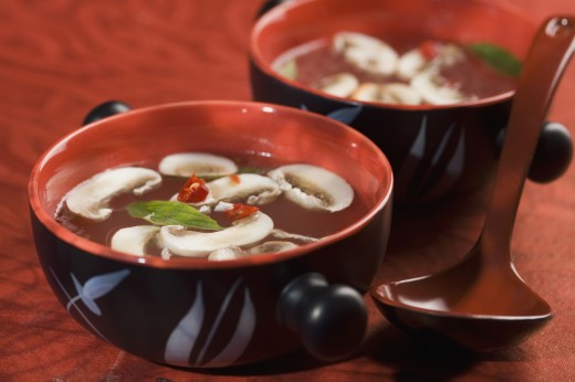 Close-up of bowls of Oriental mushroom soup : Stock Photo