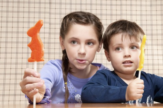 Boy and his sister holding candies : Stock Photo
