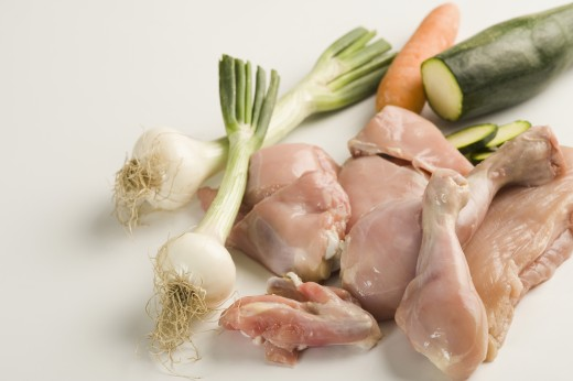 Close-up of raw chicken with vegetables : Stock Photo