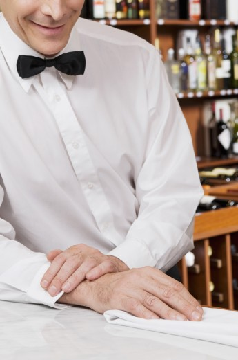 Stock Photo: 1884-62888 Waiter leaning against a bar counter