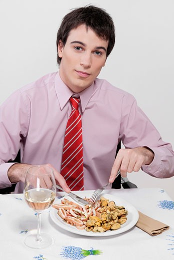 Stock Photo: 1884-62984 Portrait of a businessman having lunch