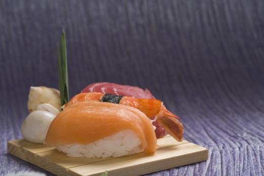 Stock Photo: 1884-63051 Close-up of nigiri sushi on a cutting board