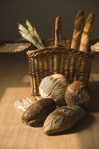 Close-up of breads with wicker basket : Stock Photo