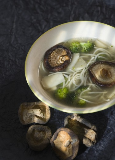 Stock Photo: 1884-63097 High angle view of a bowl of mushroom and noodle soup