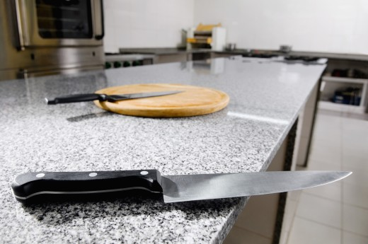 Kitchen knives with a cutting board : Stock Photo