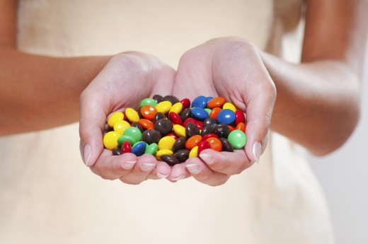 Handful of candy : Stock Photo
