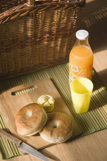 Close-up of breads with knife and a bottle of juice : Stock Photo