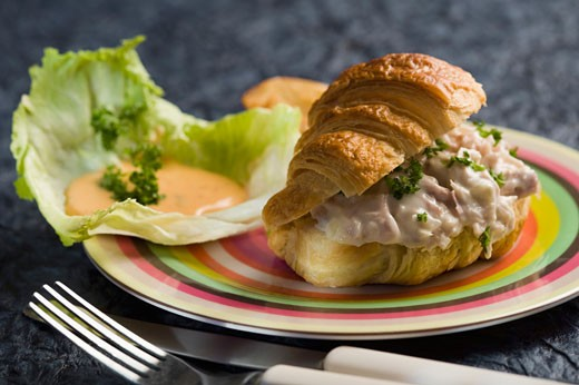 Close-up of a tuna stuffed croissant : Stock Photo