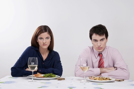 Portrait of a couple sulking at the dinner table : Stock Photo
