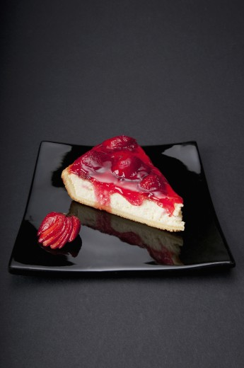 Stock Photo: 1884-63838 High angle view of a strawberry cheesecake on a tray