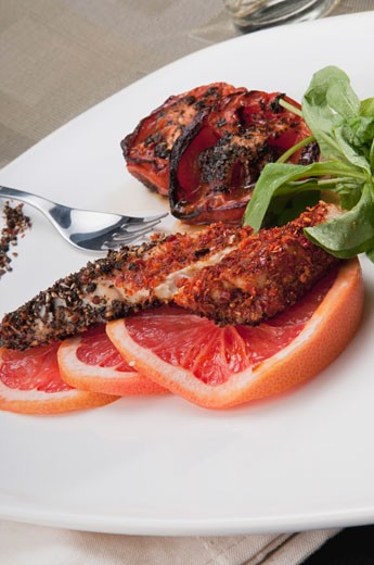 Stock Photo: 1884-64103 Close-up of pepper coated chops with grapefruit