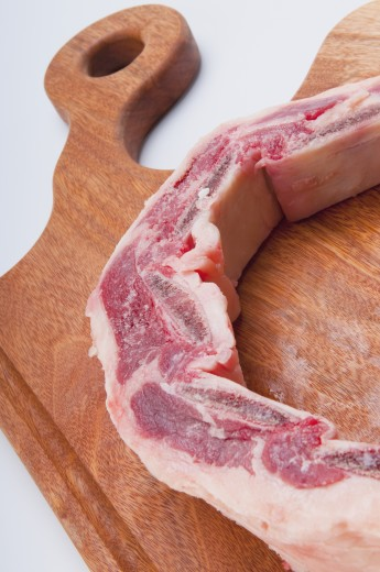 Stock Photo: 1884-64441 Close-up of raw spare ribs on a cutting board