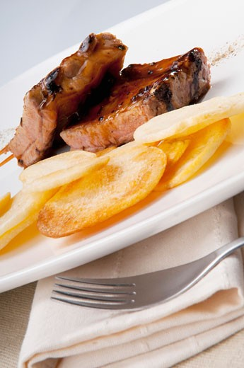 Close-up of spare ribs and chips : Stock Photo
