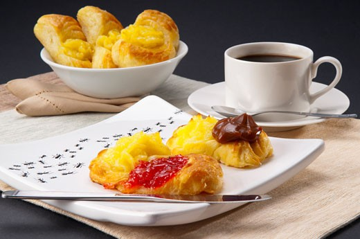 Stock Photo: 1884-64636 Close-up of danish pastries served with a cup of coffee