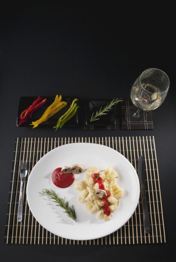 Stock Photo: 1884-64707 Rosemary garnish on conchiglie pasta with mushrooms