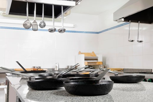 Stock Photo: 1884-64722 Frying pans in the kitchen