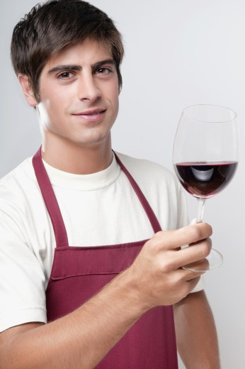 Stock Photo: 1884-64825 Portrait of a man holding a glass of red wine