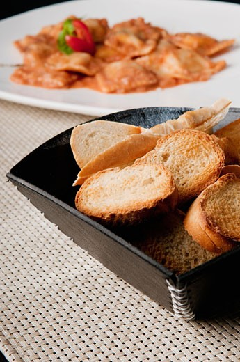 Stock Photo: 1884-65141 Close-up of crusty bread served with ravioli