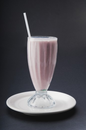 Close-up of a strawberry milkshake : Stock Photo