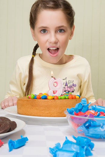 Portrait of a girl with a birthday cake : Stock Photo