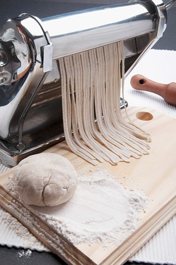 Pasta maker making spaghetti : Stock Photo