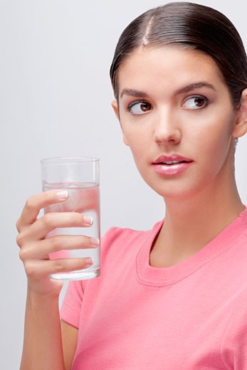 Stock Photo: 1884-66121 Close-up of a woman holding a glass of water