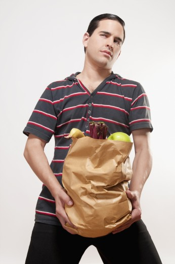 Stock Photo: 1884-66133 Close-up of a man holding a bag of fruits and vegetables