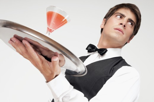 Stock Photo: 1884-66492 Close-up of a waiter holding a cocktail on a tray