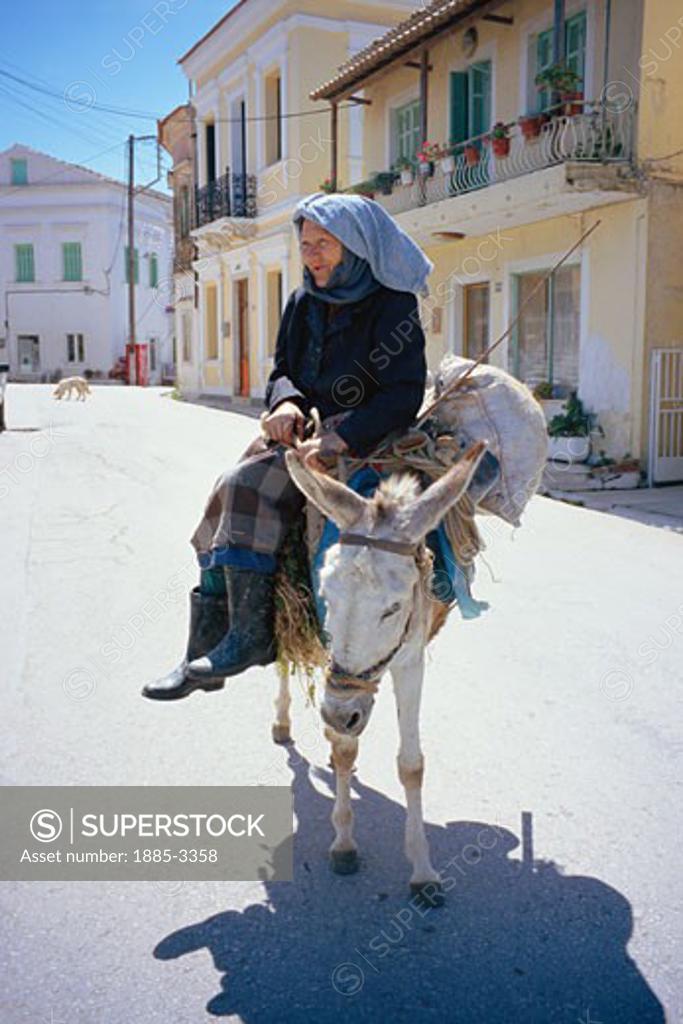 Stock Photo: 1885-3358 Greek Islands, Corfu , Lefkimi Village, Old Lady on Her Donkey
