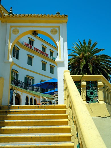Morocco, , Tangier, View of colourful hotel through archway : Stock Photo