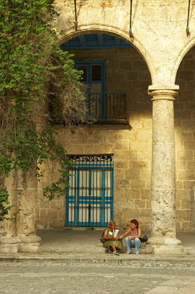 Caribbean, Cuba, Havana, Tourists at the Palacio de los Marqueses de Arcos in Plaza de la Catedral  : Stock Photo