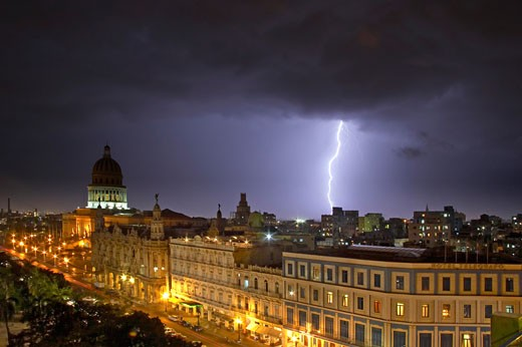 Caribbean, Cuba, Havana, Tropical storm over the city at night : Stock Photo